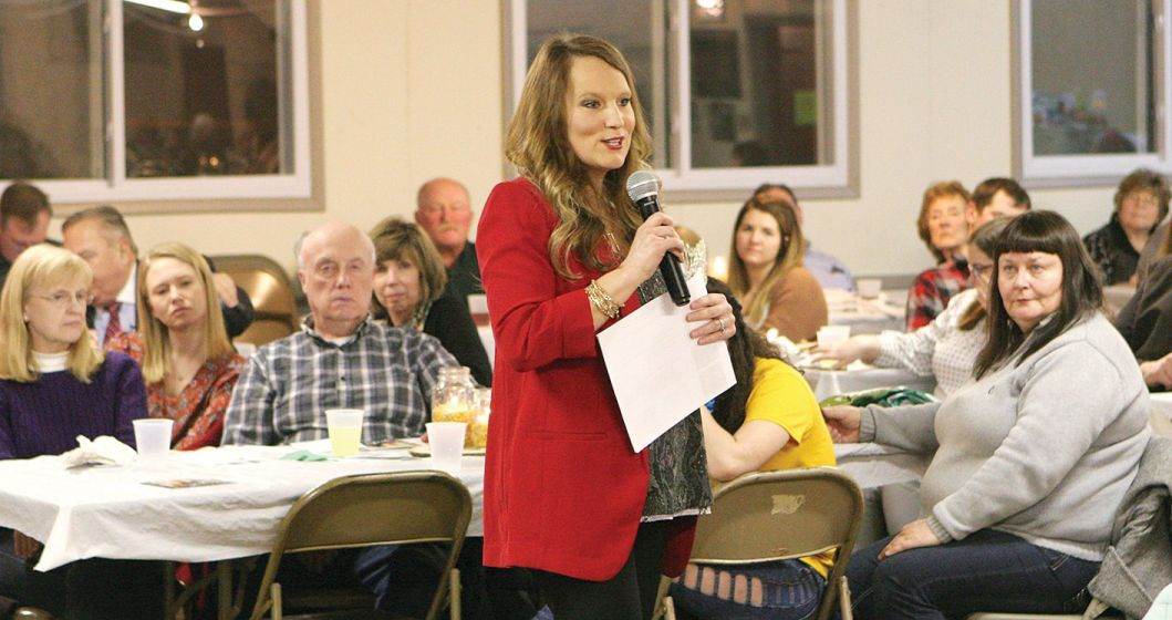 Featured speaker Adrienne DeSutter shares with a room rull of farm families at an event hosted by Cross Over Ministries and the Montgomery County Farm Bureau.